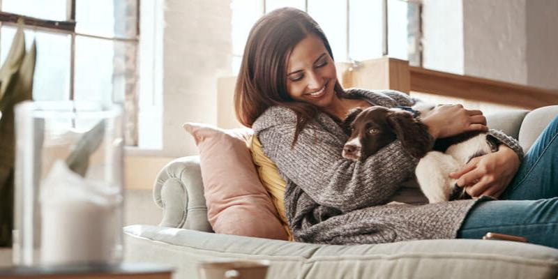 Woman with dog on couch